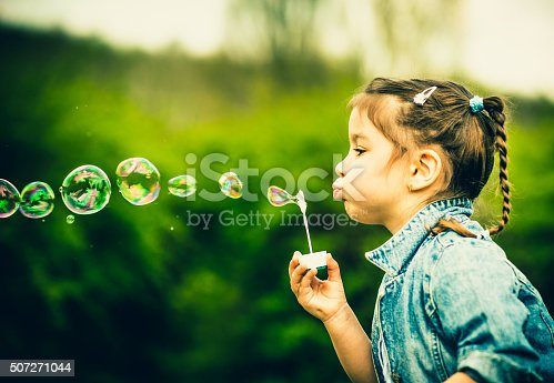507271044istockphoto Happy little pretty girl outdoor in the park 507271044