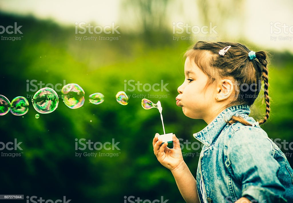 Happy little pretty girl outdoor in the park stock photo