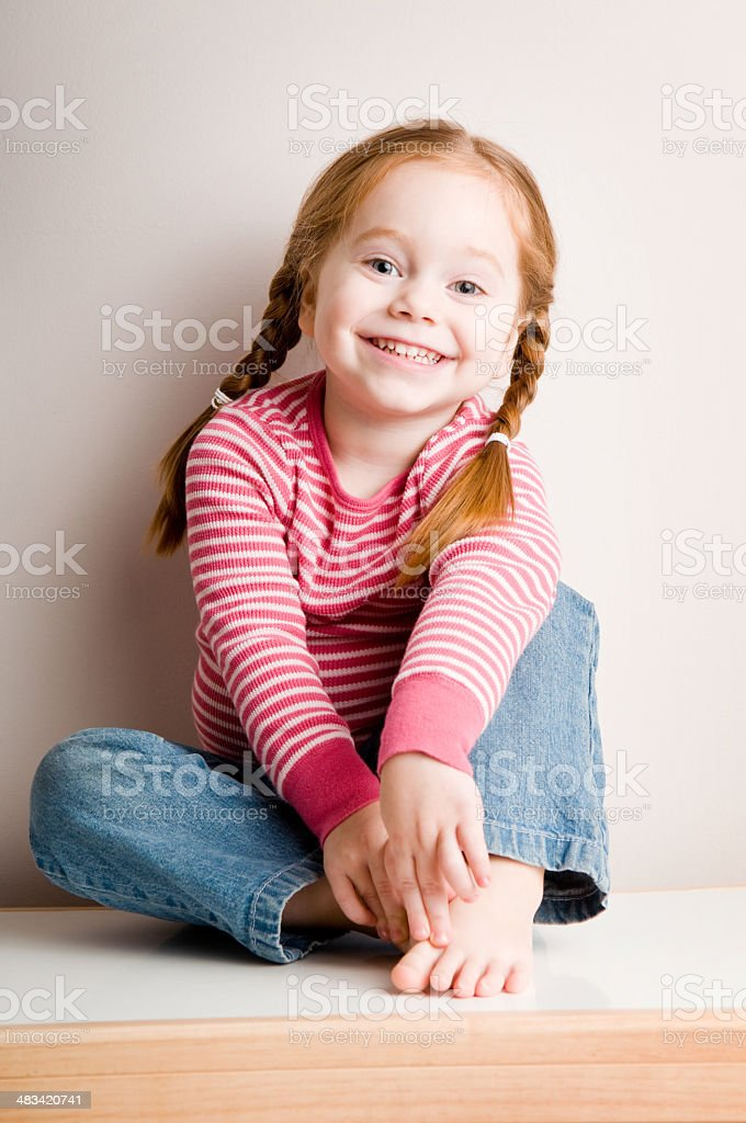 Happy Little Redhead Smiling Sweetly royalty-free stock photo