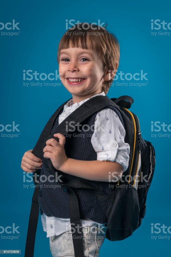 fdddeec434 Happy little school boy over colored background royalty-free stock photo