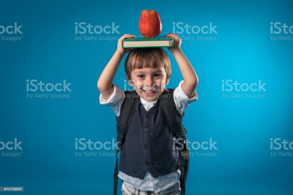 3d7f6f096d Happy Little School Boy Over Colored Background Stock Photo   More ...