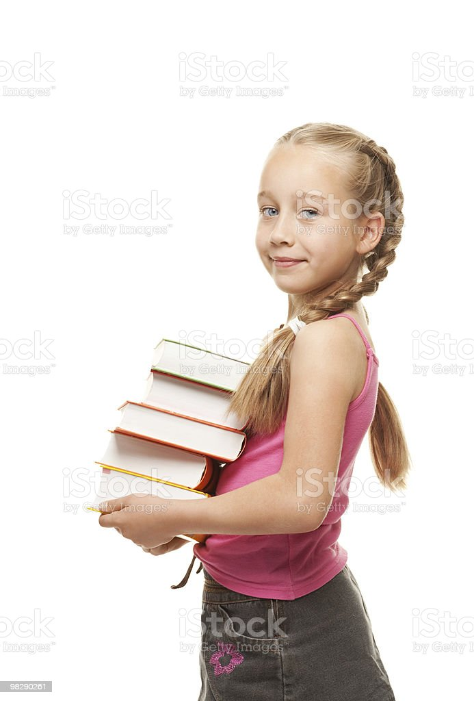 Happy little schoolgirl with a stack of heavy books royalty-free stock photo