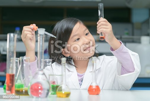 istock Happy little scientist making experiment 950720286