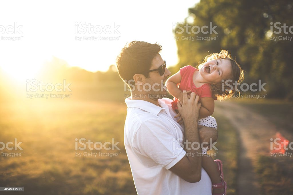 Happy little toddler girl with her father stock photo