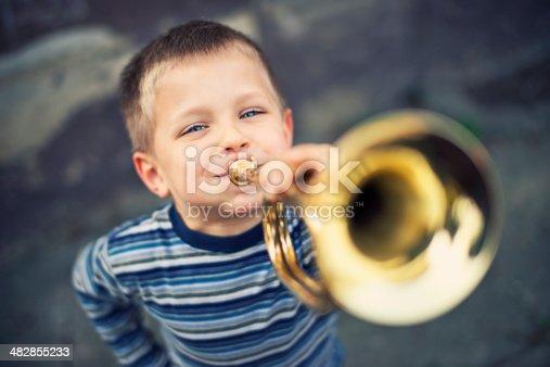 Little boy playing trumpet