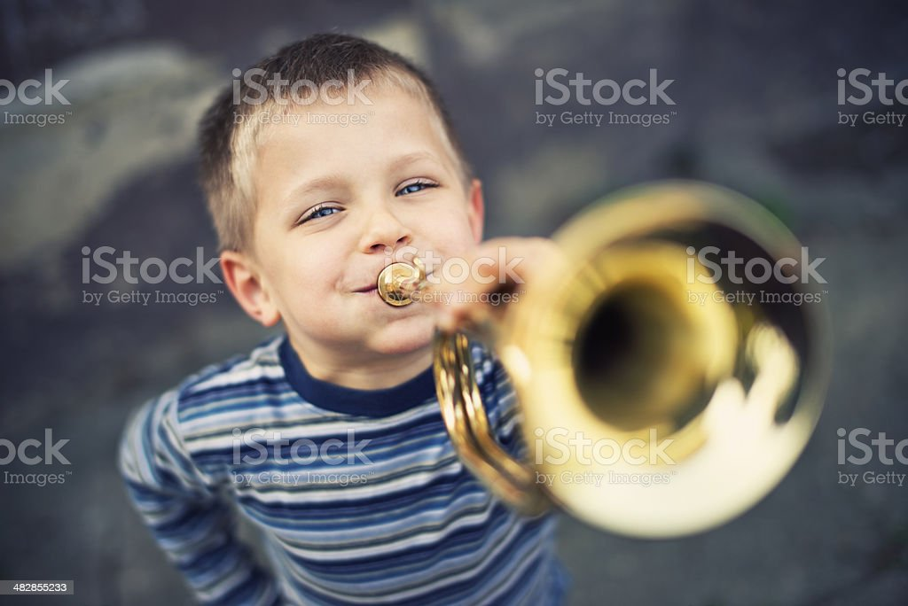 Happy little trumpeter stock photo