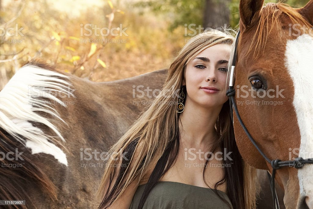 Happy Long-Haired Teen Girl & Horse Together stock photo