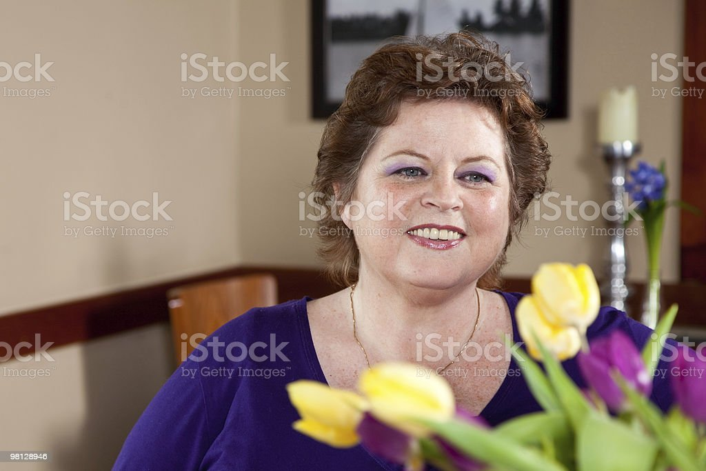 Happy looking woman in a restaurant royalty-free stock photo
