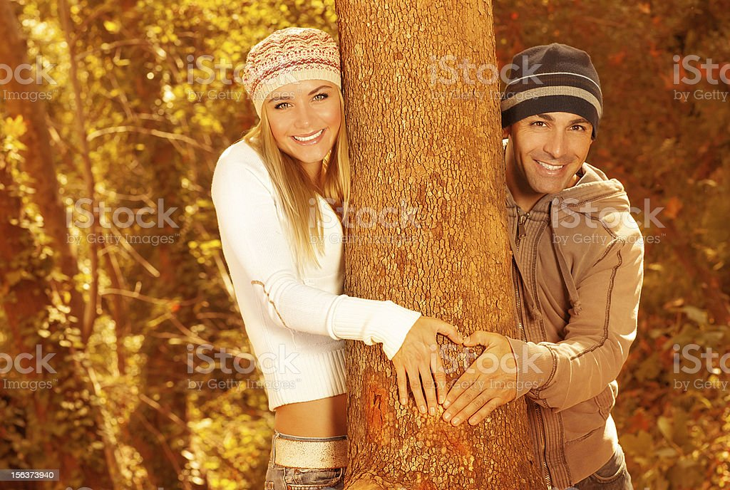 Happy lovers in autumn forest royalty-free stock photo