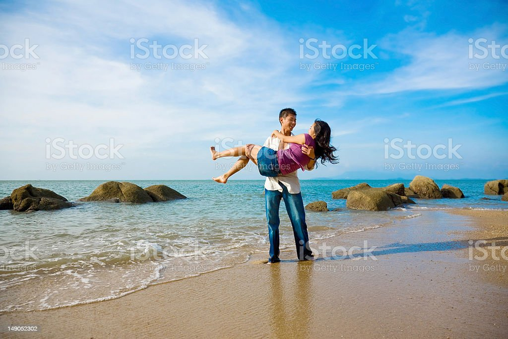 happy loving couple having fun at the beach royalty-free stock photo