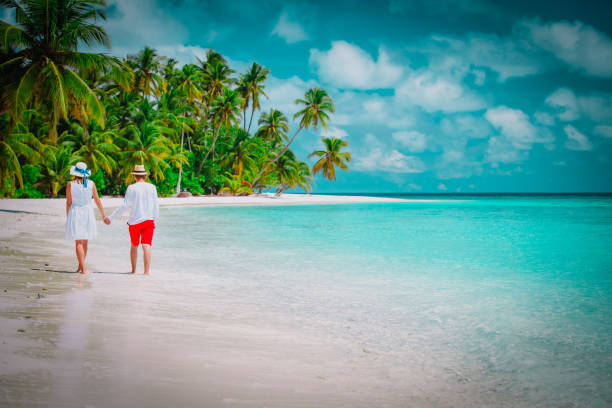 happy loving couple walk on beach, vacation concept happy loving couple walk on tropical beach, vacation concept romance stock pictures, royalty-free photos & images