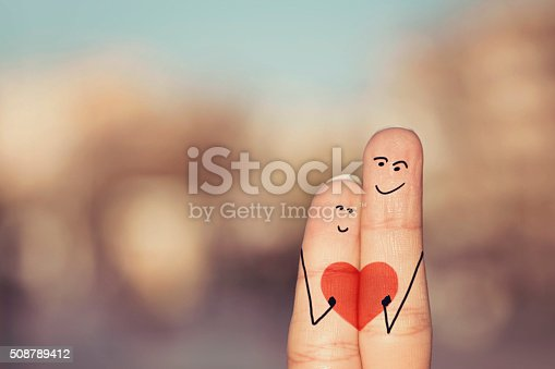 istock Happy loving fingers holding red heart 508789412