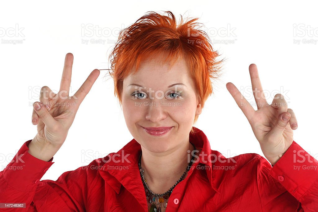 Happy lucky young woman with Victory gesture royalty-free stock photo