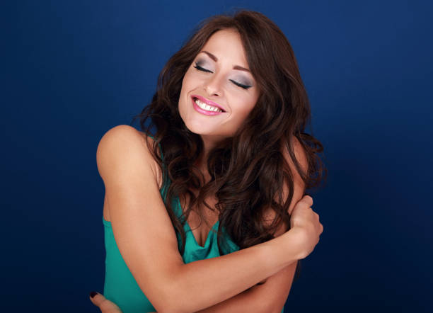 Happy makeup woman hugging herself with natural emotional enjoying face. Love concept of yourself body - Photo