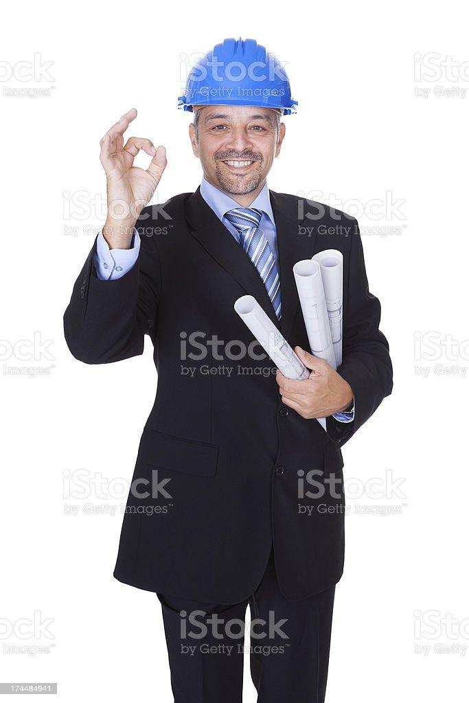 Happy Male Architect Offering Handshake royalty-free stock photo