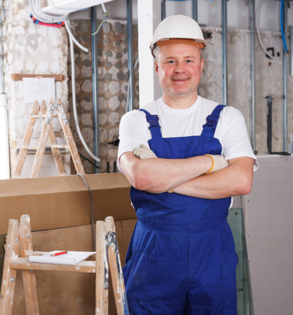 Happy male contractor Portrait of happy male contractor inside building in process of construction approbation stock pictures, royalty-free photos & images
