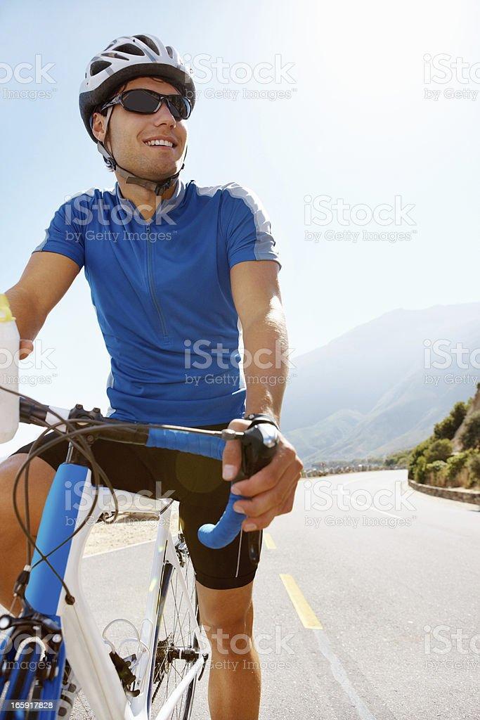 Happy male cyclist taking break royalty-free stock photo