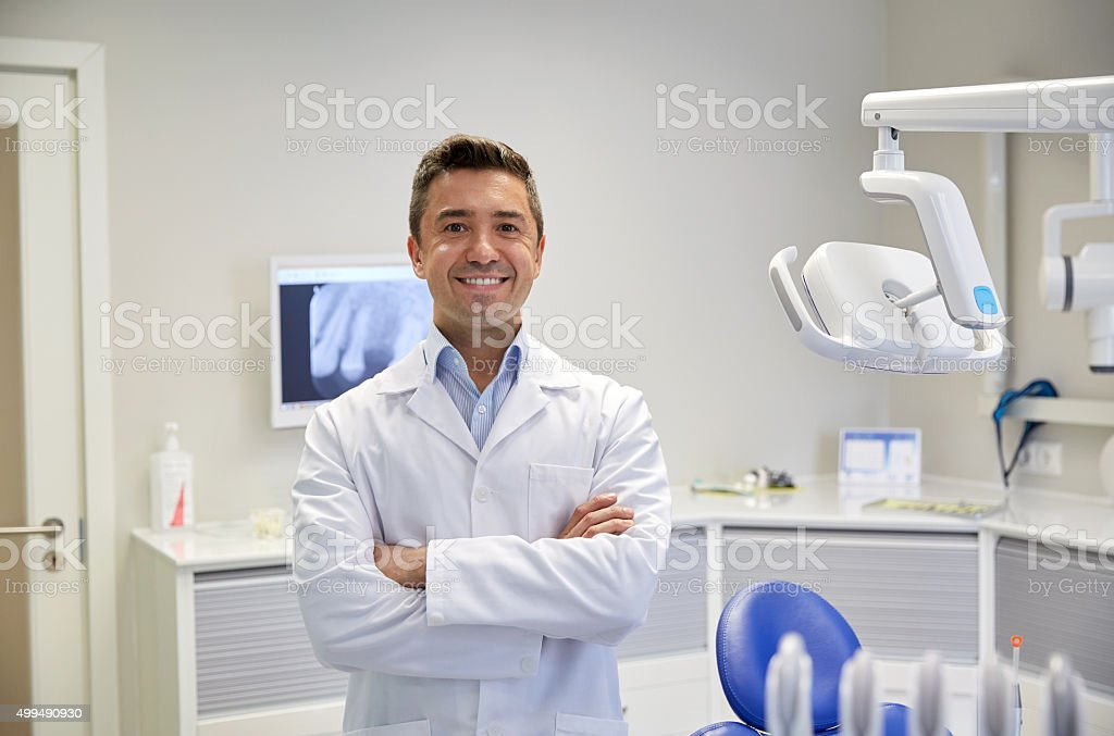 happy male dentist at dental clinic office stock photo
