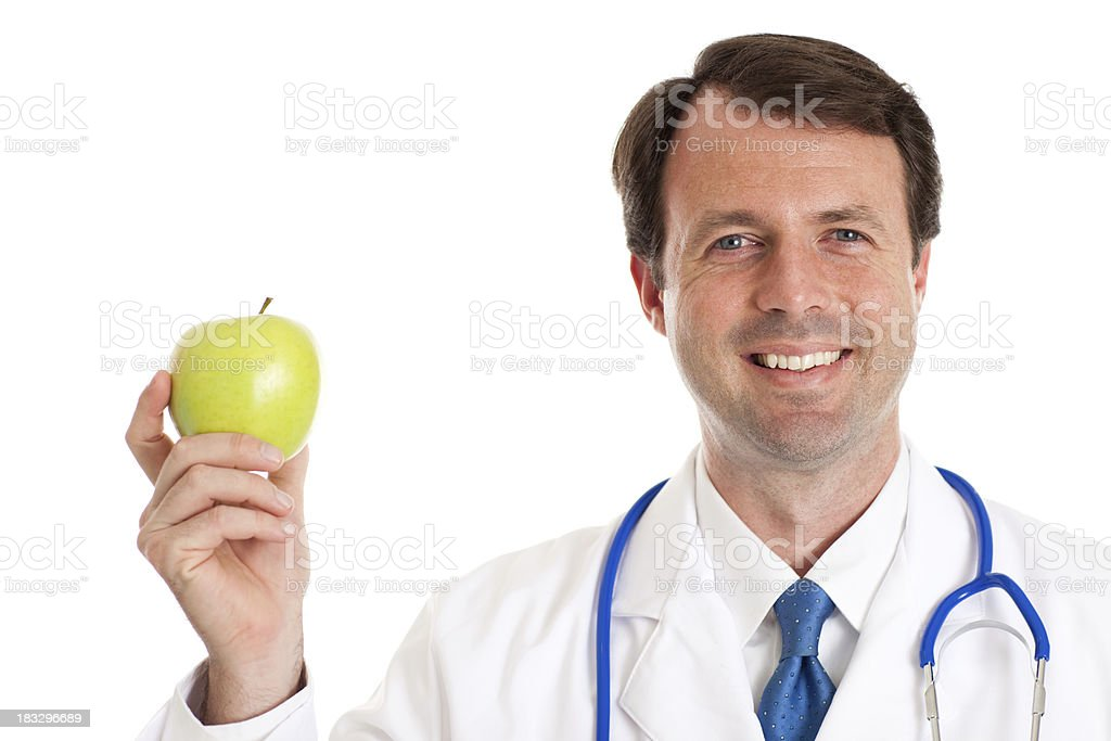 Happy Male Doctor Holding Apple Isolated on White royalty-free stock photo