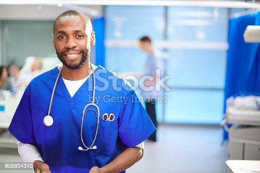 istock happy male doctor on the ward 906854310