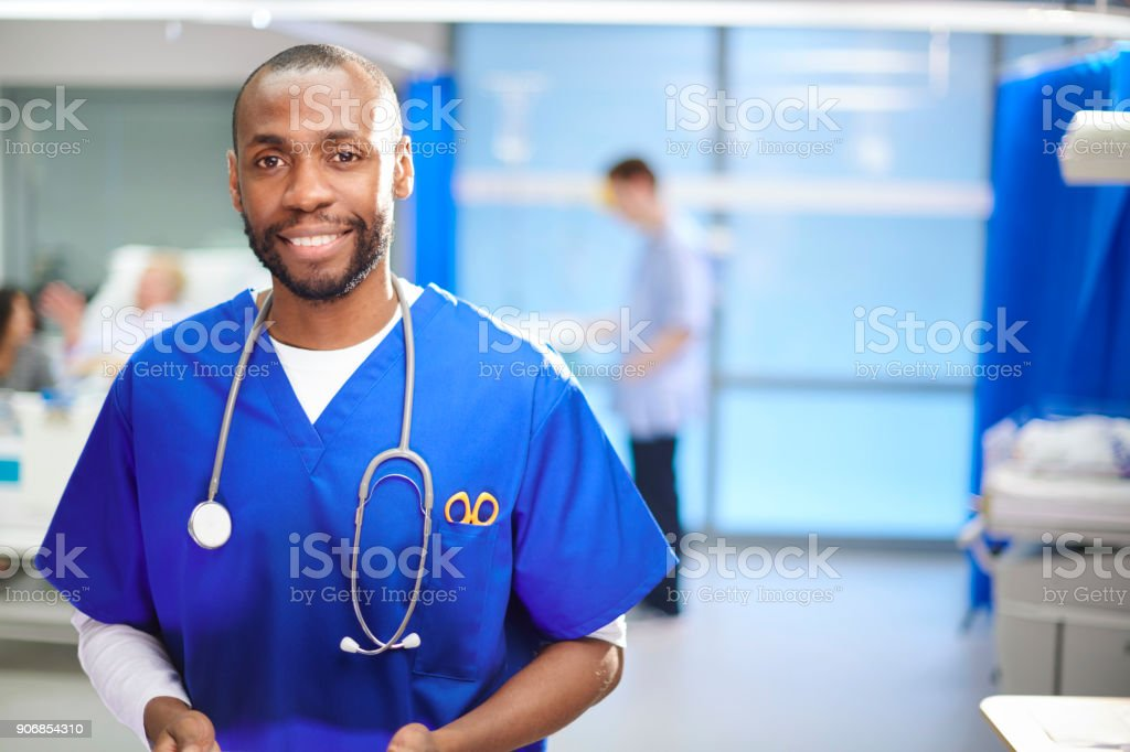 happy male doctor on the ward stock photo