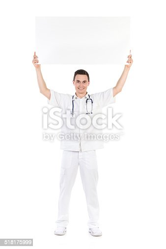 istock Happy male doctor showing empty placard over his head 518175999