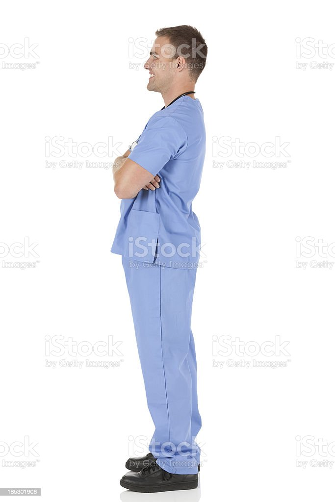 Happy male doctor standing with his arms crossed royalty-free stock photo