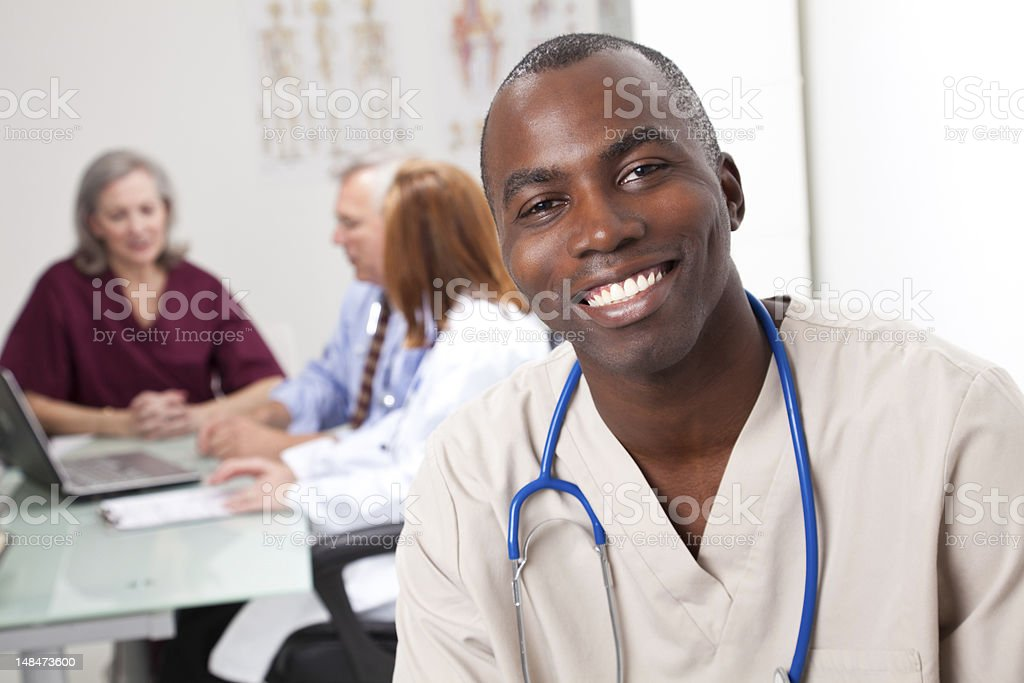 Happy Male Nurse at a Physician's Office royalty-free stock photo