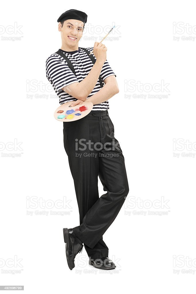 Happy male painter holding a paintbrush stock photo