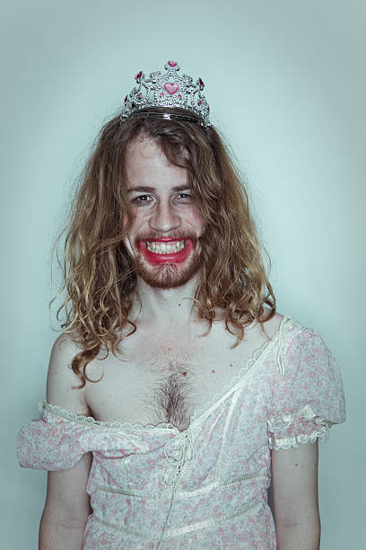 happy male prom queen in drag tiara on head lipstick - transvestite stock photos and pictures