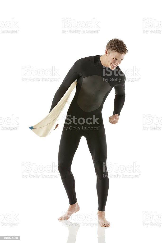 Happy male surfer with a surfboard royalty-free stock photo