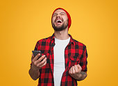 istock Happy male with smartphone celebrating success 1087238520