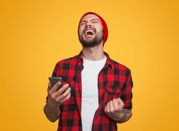 Happy male with smartphone celebrating success picture id1087238520?b=1&k=6&m=1087238520&s=612x612&w=0&h=mfj06v5 qimnwybq8mnuwknve5mnarqorj8mmh2qwu8=