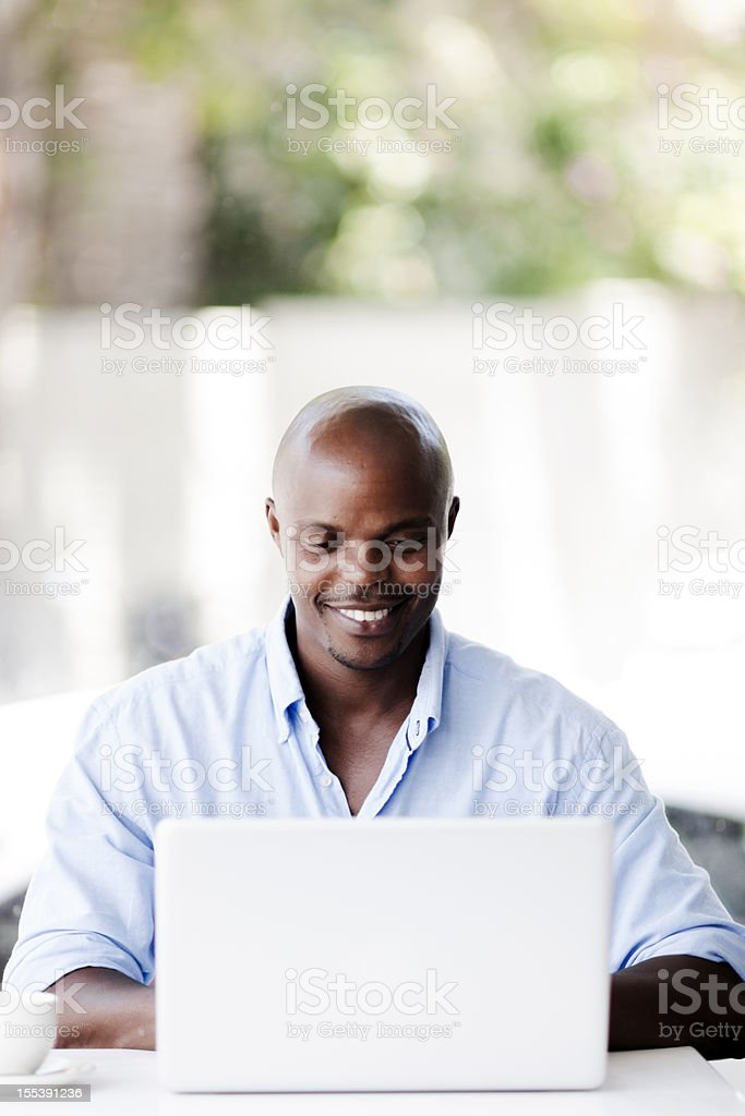 Happy male working on laptop royalty-free stock photo