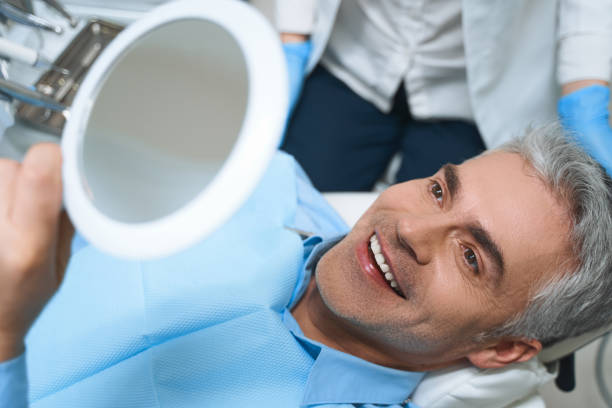 Happy man after dental procedures stock photo stock photo