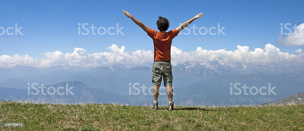 Happy Man against deep Blu Sky in the Dolomites royalty-free stock photo