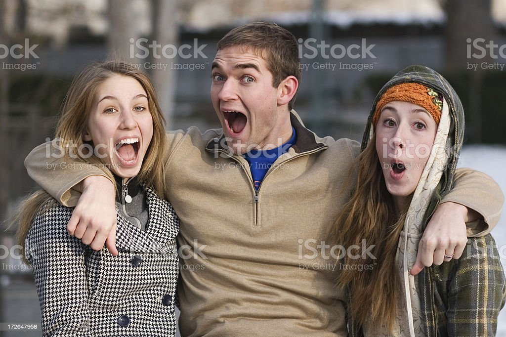 Happy Man and Two Women Friends Laughing Outdoors royalty-free stock photo