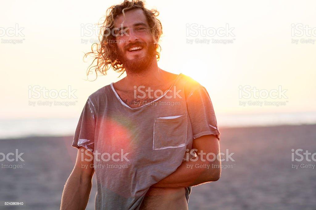 Happy man at the beach stock photo