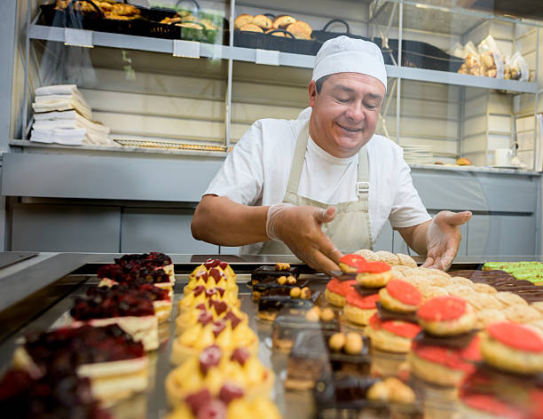Happy man baking sweet treats stock photo