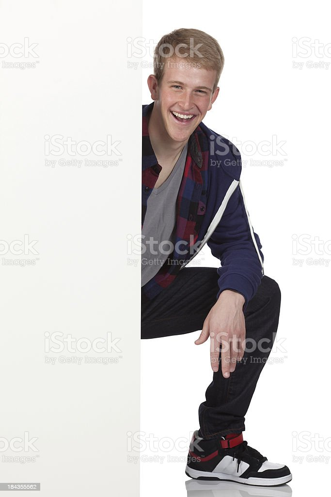 Happy man behind a placard stock photo