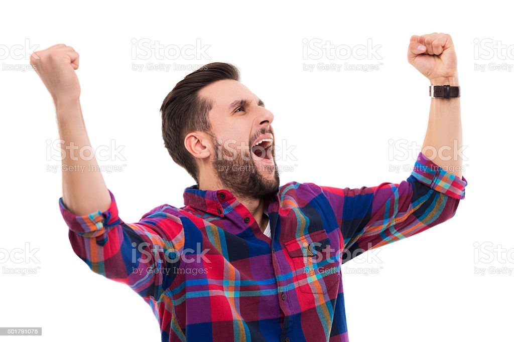 Happy man clenching fists stock photo