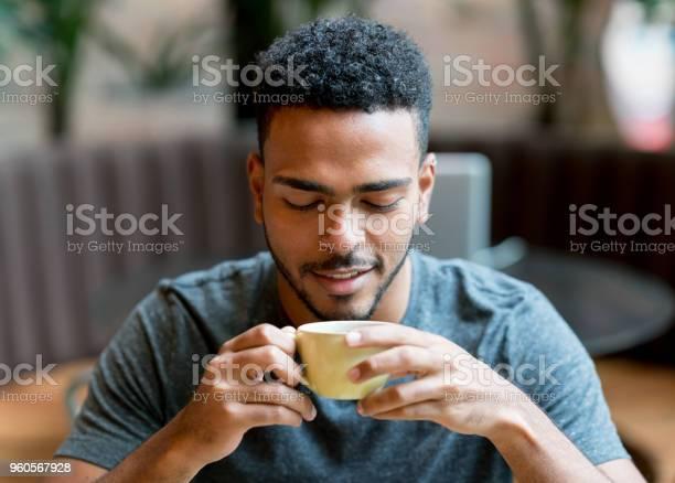 Happy man drinking a cup of coffee at a cafe picture id960567928?b=1&k=6&m=960567928&s=612x612&h=mqr9b26fjvmskowanv0lsddzhshlsouu5pzxdjh1ryu=