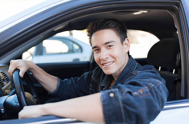 Happy man driver Happy male driver. handsome asian man in car stock pictures, royalty-free photos & images