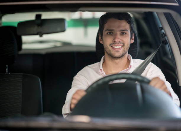 happy man driving a car at the garage - driver stock photos and pictures