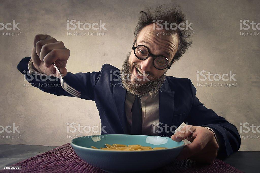 Happy man eating pasta stock photo