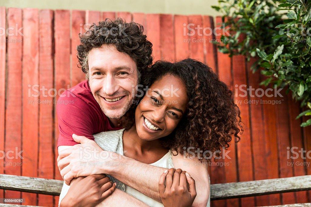 Happy man embracing woman at yard – Foto