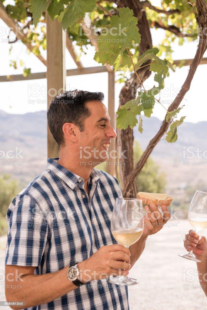 A happy man enjoying a glass of wine stock photo
