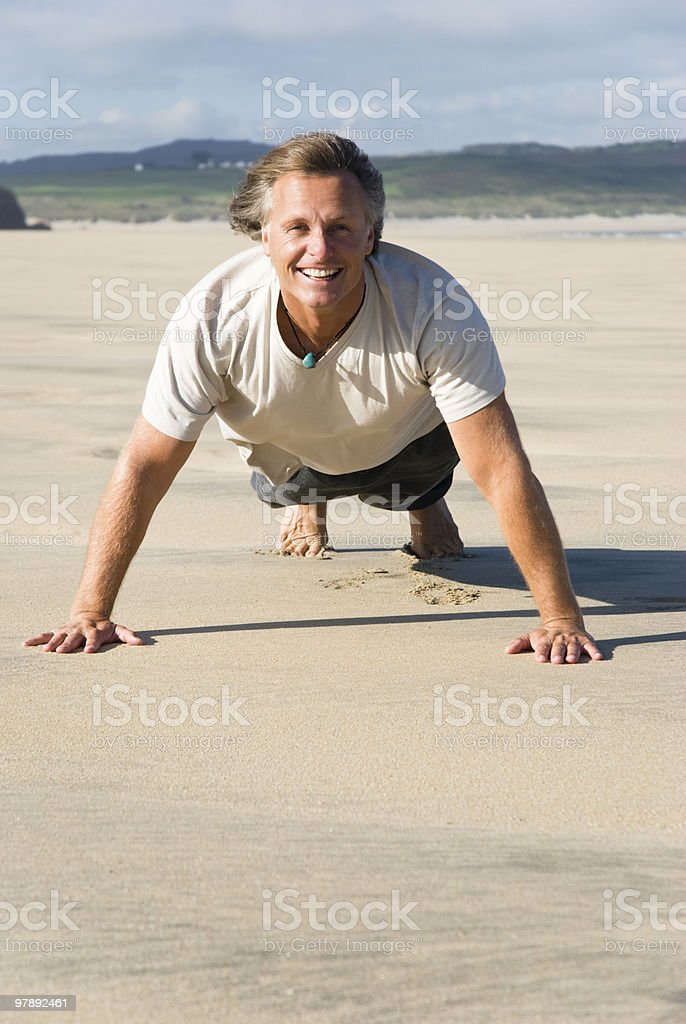 happy man exercising on beach. royalty-free stock photo
