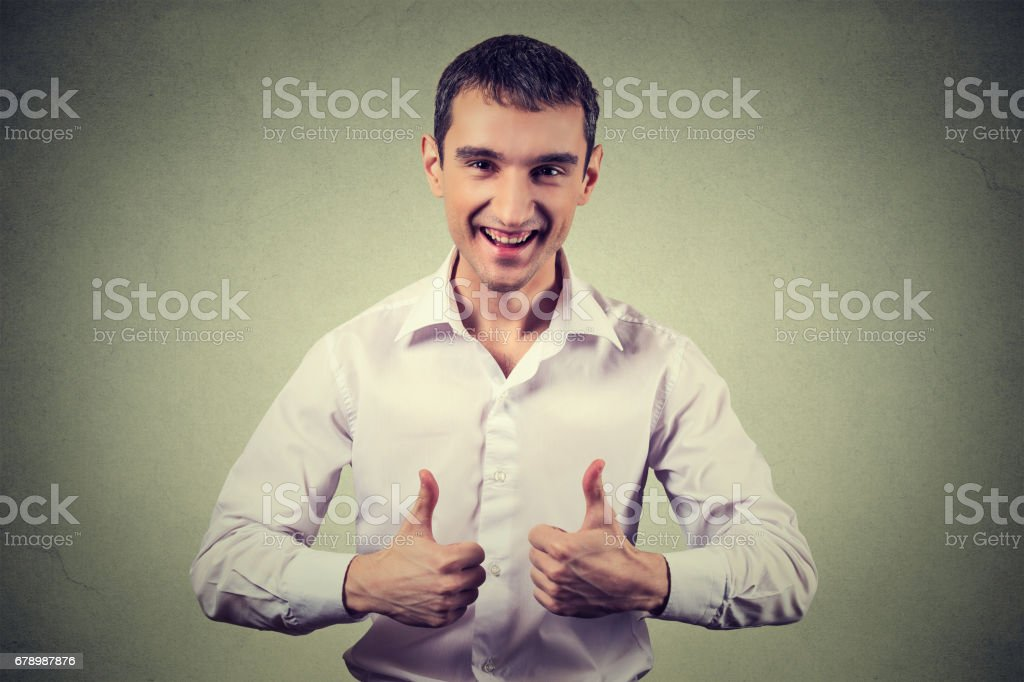 Happy man giving thumbs up sign royalty-free stock photo