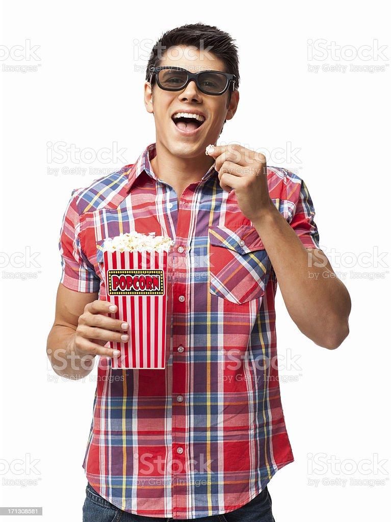 Homme heureux ayant du pop-corn-isolé - Photo
